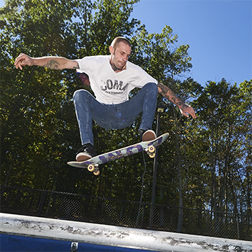 Brent Cordy rides one of his Coma skateboards.
