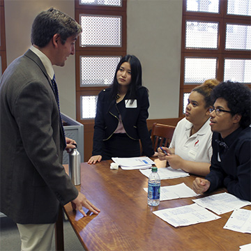 Law student William Price talks to Hartford High students at the 2016 mock trial.
